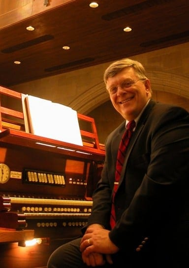 Buzard Organs' founder, John-Paul Buzard, seated at his Opus 7 at The Chapel of St. John the Divine Champaign, Illinois