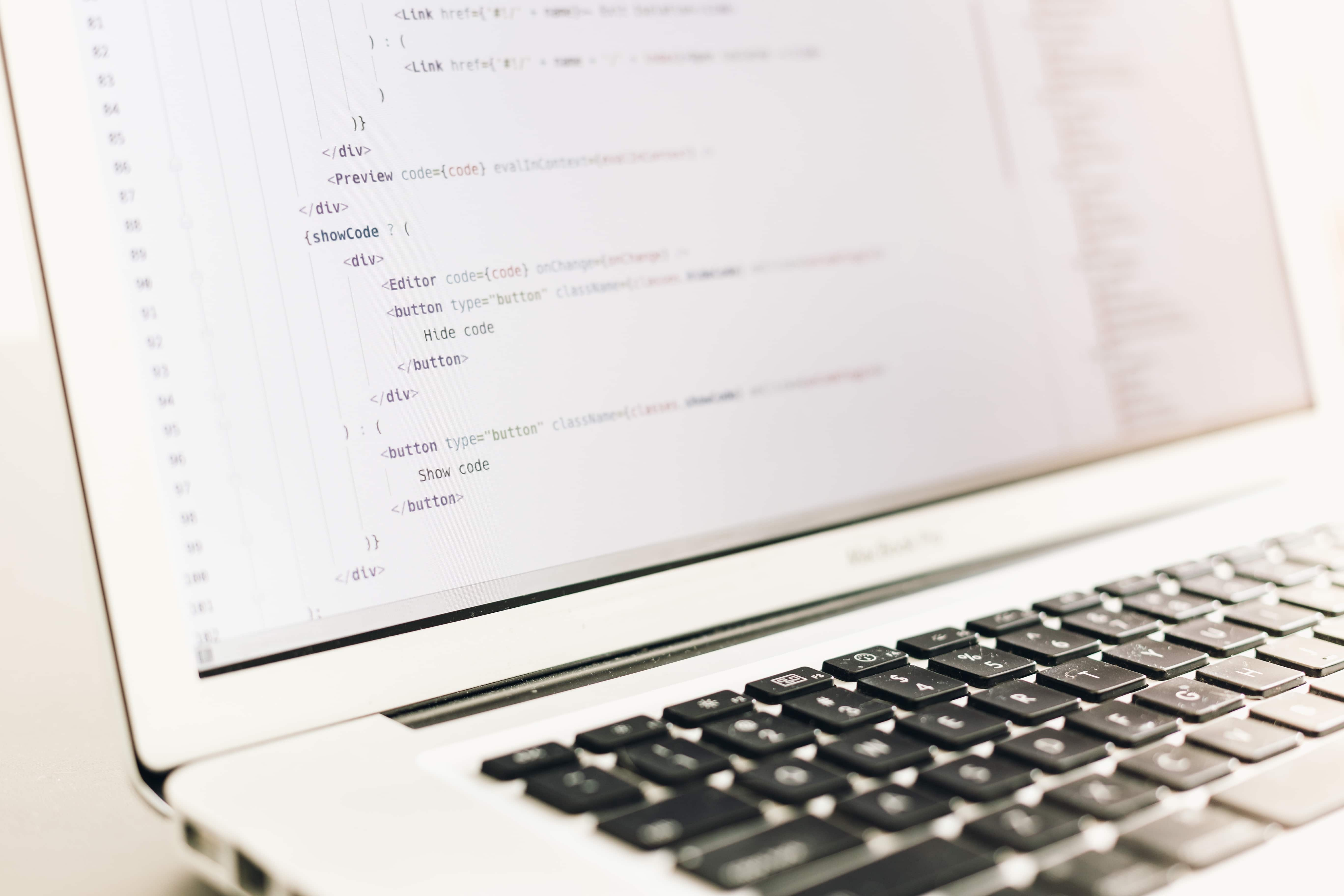 image of a laptop with coding