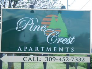 old Pine Crest Apartments logo