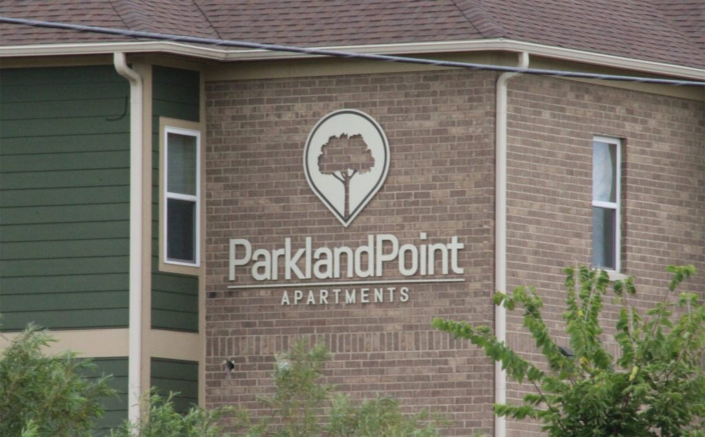 outdoor signage at Parkland Point Apartments