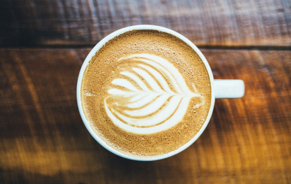 flat lay photography example of coffee mug on table