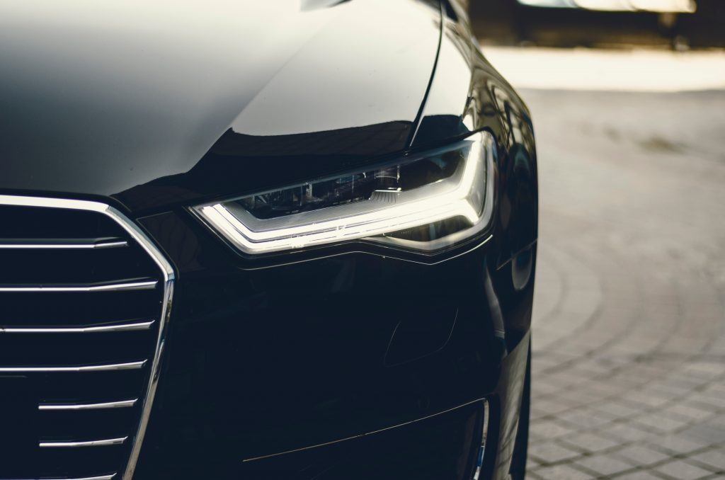 close up photography of car headlight and grille